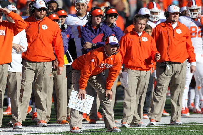 Oct 26, 2013; College Park, MD, USA; Clemson Tigers head coach Dabo Sweeny (center) watches a field goal attempt during the game against the Maryland Terrapins at Byrd Stadium. Mandatory Credit: Mitch Stringer-USA TODAY Sports