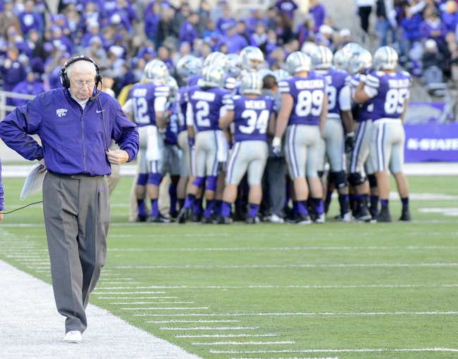 Oct 26, 2013; Manhattan, KS, USA; Kansas State Wildcats head coach Bill Snyder walks the sidelines during a timeout in the second half against the West Virginia Mountaineers at Bill Snyder Family Stadium. The Wildcats defeat the Mountaineers 35-12. Mandatory Credit: Jasen Vinlove-USA TODAY Sports