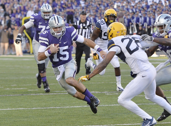 Oct 26, 2013; Manhattan, KS, USA; Kansas State Wildcats quarterback Jake Waters (15) runs the ball against the West Virginia Mountaineers during the second half at Bill Snyder Family Stadium. The Wildcats defeat the Mountaineers 35-12. Mandatory Credit: Jasen Vinlove-USA TODAY Sports