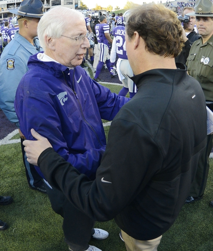 Oct 26, 2013; Manhattan, KS, USA; Kansas State Wildcats head coach Bill Snyder and West Virginia Mountaineers head coach Dana Holgorsen shake hands after the game at Bill Snyder Family Stadium. The Wildcats defeat the Mountaineers 35-12. Mandatory Credit: Jasen Vinlove-USA TODAY Sports