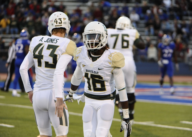 Oct 26, 2013; Lawrence, KS, USA; Baylor Bears wide receiver Tevin Reese (16) is congratulated by kicker Aaron Jones (43) after scoring a touchdown against Kansas Jayhawks in the first half at Memorial Stadium. Mandatory Credit: John Rieger-USA TODAY Sports