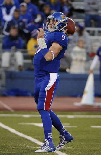 Oct 26, 2013; Lawrence, KS, USA; Kansas Jayhawks quarterback Jake Heaps (9) drops back to pass against the Baylor Bears in the first half at Memorial Stadium. Mandatory Credit: John Rieger-USA TODAY Sports