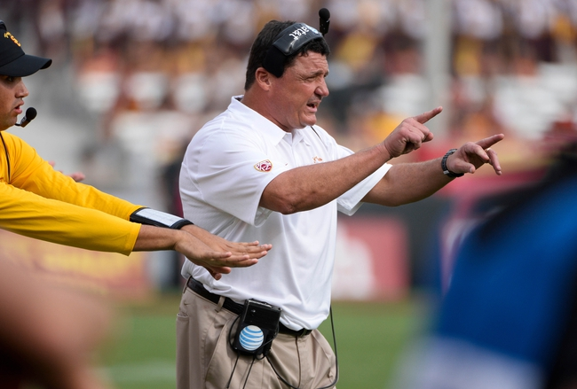 Oct 26, 2013; Los Angeles, CA, USA;  USC head coach Ed Orgeron signals to players during the second half against the Utah Utes at Los Angeles Memorial Coliseum. The Trojans went on to a 190-3 win. Mandatory Credit: Robert Hanashiro-USA TODAY Sports