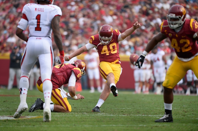Oct 26, 2013; Los Angeles, CA, USA;  USC Trojans kicker Andre Heidari (48) kicks a  40-yard field goal during the second half against the Utah Utes at Los Angeles Memorial Coliseum. The holder is Cody Kessler (6). The Trojans went on to a 19-0 win as Heidari hit four field goals in the game. Mandatory Credit: Robert Hanashiro-USA TODAY Sports