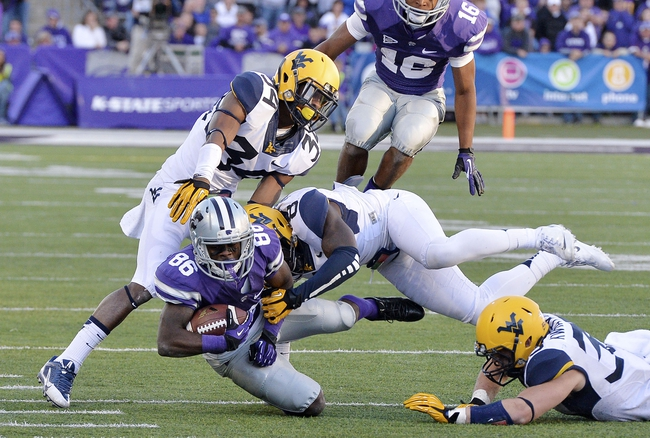 Oct 26, 2013; Manhattan, KS, USA; Kansas State Wildcats wide receiver Tramaine Thompson (86) is tackled by West Virginia Mountaineers safety Karl Joseph (8) during the second half at Bill Snyder Family Stadium. The Wildcats defeat the Mountaineers 35-12. Mandatory Credit: Jasen Vinlove-USA TODAY Sports