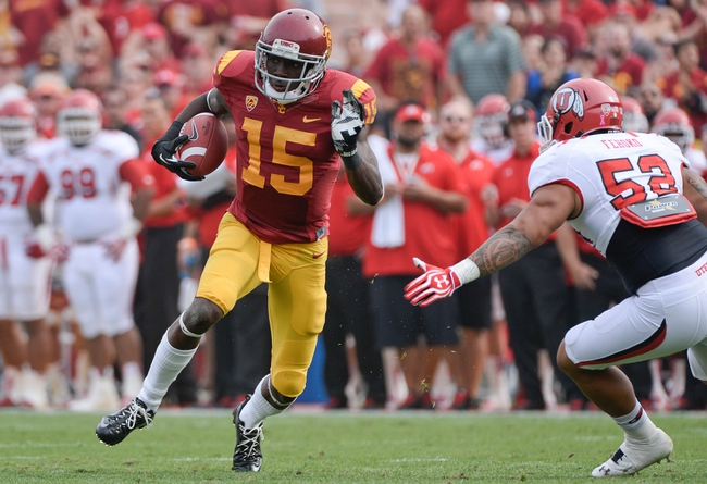 Oct 26, 2013; Los Angeles, CA, USA;  USC Trojans wide receiver Nelson Agholor (15) tries to run past Utah Utes linebacker V.J. Fehoko (52) for a big gain during third quarter action at Los Angeles Memorial Coliseum. The Trojans won 19-3. Mandatory Credit: Robert Hanashiro-USA TODAY Sports