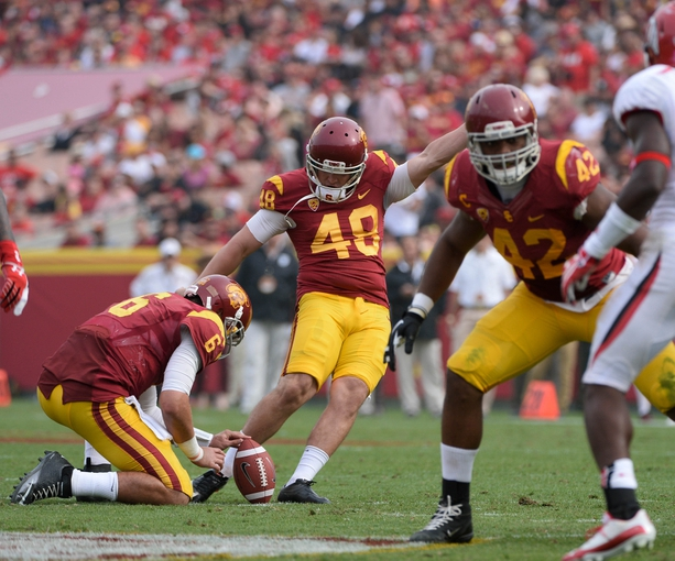 Oct 26, 2013; Los Angeles, CA, USA; USC Trojans kicker Andre Heidari (48)  hits a 40-yard field goal against the Utah Utes during the second half of the Trojans 19-3 win at Los Angeles Memorial Coliseum. Mandatory Credit: Robert Hanashiro-USA TODAY Sports
