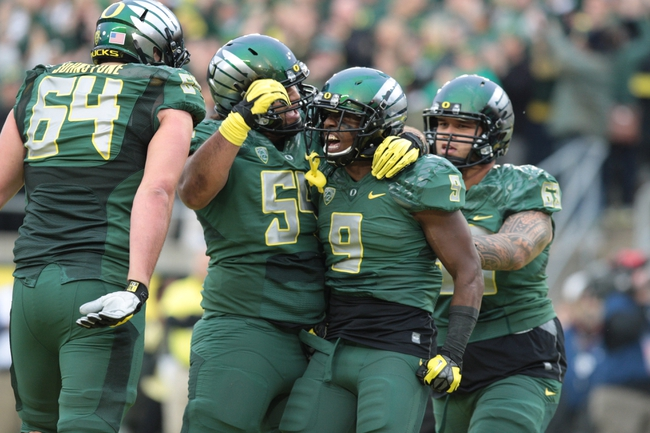 Oct 26, 2013; Eugene, OR, USA; Oregon Ducks offensive linesman Hamani Stevens (54) celebrates with running back Byron Marshall (9) following a touchdown against the UCLA Bruins at Autzen Stadium. Mandatory Credit: Scott Olmos-USA TODAY Sports