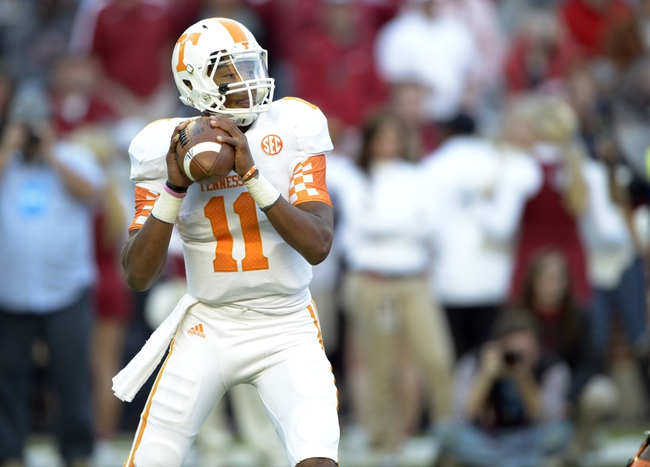 Oct 26, 2013; Tuscaloosa, AL, USA; Tennessee Volunteers quarterback Joshua Dobbs (11) drops back to pass against the Alabama Crimson Tide during the first quarter at Bryant-Denny Stadium. Mandatory Credit: John David Mercer-USA TODAY Sports