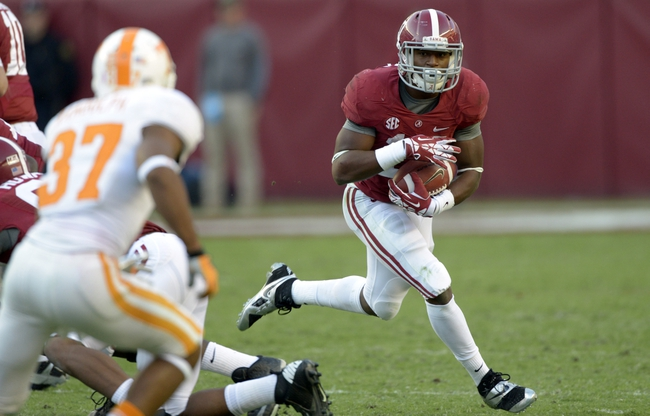 Oct 26, 2013; Tuscaloosa, AL, USA; Alabama Crimson Tide running back Kenyan Drake (17) rushes against the Tennessee Volunteers during the fourth quarter at Bryant-Denny Stadium. Mandatory Credit: John David Mercer-USA TODAY Sports