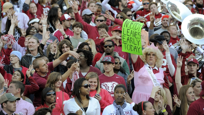 Oct 26, 2013; Tuscaloosa, AL, USA; Alabama Crimson Tide fan holds a sign trying to keep fans in the stands against the Tennessee Volunteers at Bryant-Denny Stadium. Mandatory Credit: John David Mercer-USA TODAY Sports