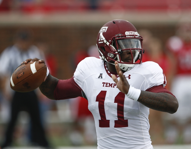Oct 26, 2013; Dallas, TX, USA; Temple Owls quarterback P.J. Walker (11) sets to throw a pass against the Southern Methodist Mustangs during the first half at Gerald J. Ford Stadium. Mandatory Credit: Jim Cowsert-USA TODAY Sports