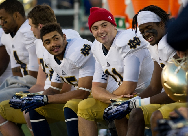 Oct 26, 2013; Colorado Springs, CO, USA; Notre Dame Fighting Irish quarterback Tommy Rees (11) smiles on the bench in the fourth quarter against the Air Force Falcons at Falcon Stadium. Mandatory Credit: Matt Cashore-USA TODAY Sports
