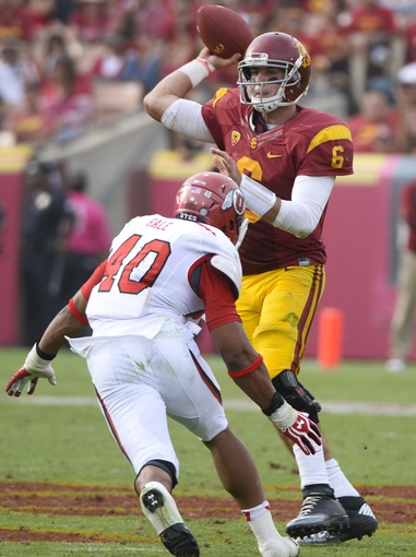 Oct 26, 2013; Los Angeles, CA, USA;  USC Trojans quarterback Cody Kessler (6) throws a pass under pressure from Utah Utes linebacker Jacoby Hale (40) during second half action at Los Angeles Memorial Coliseum. The Trojans won 19-3. Mandatory Credit: Robert Hanashiro-USA TODAY Sports