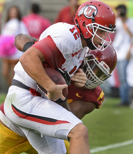 Oct 26, 2013; Los Angeles, CA, USA;  USC Trojans defensive end Leonard Williams (94) sacks Utah Utes quarterback Adam Schulz (12) for a loss during fourth quarter action at the Los Angeles Memorial Coliseum. The Trojans won 19-3. Mandatory Credit: Robert Hanashiro-USA TODAY Sports