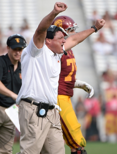 Oct 26, 2013; Los Angeles, CA, USA;  USC head coach Ed Orgeron celebrates a defensive stop in the fourth quarter against the Utah Utes at Los Angeles Memorial Coliseum. The Trojans won 19-3. Mandatory Credit: Robert Hanashiro-USA TODAY Sports