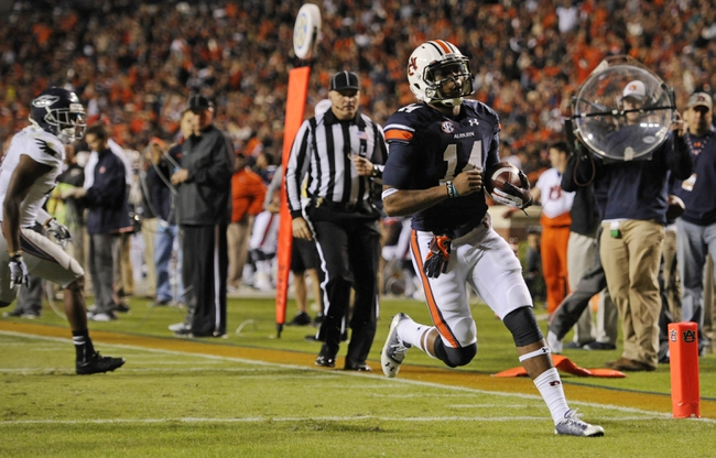 Oct 26, 2013; Auburn, AL, USA; Auburn Tigers quarterback Nick Marshall (14) runs the ball for a touchdown in the first half against the Florida Atlantic Owls at Jordan Hare Stadium. Mandatory Credit: Shanna Lockwood-USA TODAY Sports