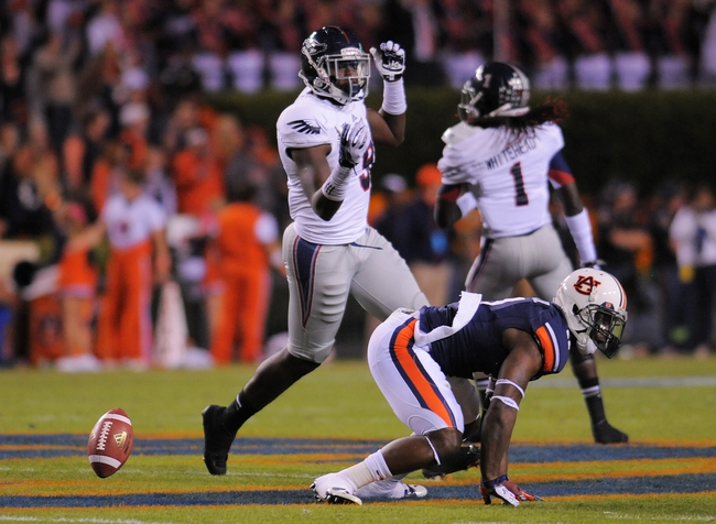 Oct 26, 2013; Auburn, AL, USA; Auburn Tigers defensive back Jermaine Whitehead (9) breaks up a pass intended for Florida Atlantic Owls tight end Nexon Dorvilus (9) during the first half at Jordan Hare Stadium. Mandatory Credit: Shanna Lockwood-USA TODAY Sports