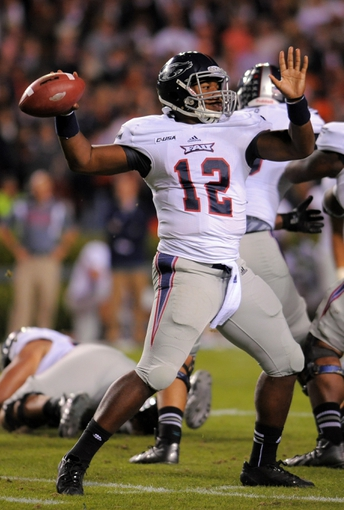 Oct 26, 2013; Auburn, AL, USA; Florida Atlantic Owls quarterback Jaquez Johnson (12) passes the ball during the first half against the Auburn Tigers at Jordan Hare Stadium. Mandatory Credit: Shanna Lockwood-USA TODAY Sports