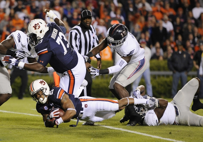 Oct 26, 2013; Auburn, AL, USA; Auburn Tigers running back Tre Mason (21) scores the first touchdown of the game against the Florida Atlantic Owls at Jordan Hare Stadium. Mandatory Credit: Shanna Lockwood-USA TODAY Sports