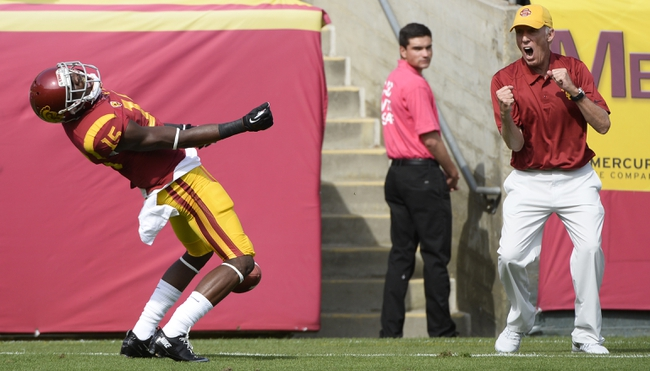 Oct 26, 2013; Los Angeles, CA, USA;  USC Trojans wide receiver Nelson Agholor (15) and a sideline spectator celebrates scoring a first quarter touchdown against the Utah Utes at Los Angeles Memorial Coliseum. The Trojans won 19-3. Mandatory Credit: Robert Hanashiro-USA TODAY Sports