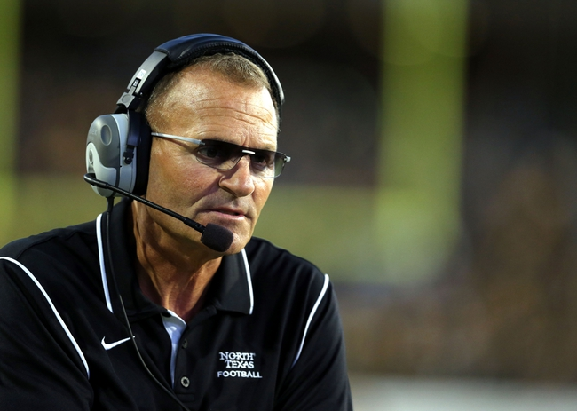 Oct 26, 2013; Hattiesburg, MS, USA; North Texas Mean Green head coach Dan McCarney watches his team play the Southern Miss Golden Eagles in the first quarter of their game at M.M. Roberts Stadium. Mandatory Credit: Chuck Cook-USA TODAY Sports