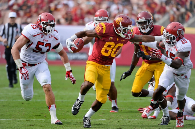 Oct 26, 2013; Los Angeles, CA, USA;  USC Trojans wide receiver De'Von Flournoy (80) runs with the ball past Utah Utes defensive back Michael Walker (15) during second quarter at Los Angeles Memorial Coliseum. The Trojans won 19-3. Mandatory Credit: Robert Hanashiro-USA TODAY Sports