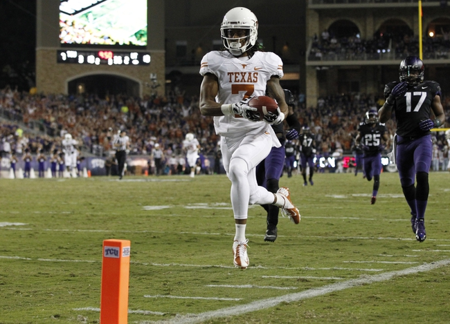 Oct 26, 2013; Fort Worth, TX, USA; Texas Longhorns wide receiver Marcus Johnson (7) runs for a touchdown after catching a pass against the TCU Horned Frogs in the second quarter at Amon G. Carter Stadium. Mandatory Credit: Tim Heitman-USA TODAY Sports