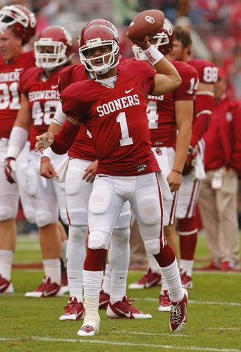 Oct 26, 2013; Norman, OK, USA; Oklahoma Sooners quarterback Kendal Thompson (1) warms up prior to the game against the Texas Tech Red Raiders at Gaylord Family - Oklahoma Memorial Stadium. Oklahoma won 38-30. Mandatory Credit: Alonzo Adams-USA TODAY Sports