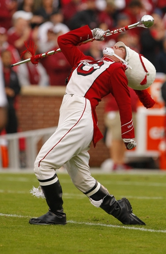 Oct 26, 2013; Norman, OK, USA; The Pride of Oklahoma Marching Band Drum Major performs during pre game between Oklahoma and the Texas Tech Red Raiders at Gaylord Family - Oklahoma Memorial Stadium. Oklahoma won 38-30. Mandatory Credit: Alonzo Adams-USA TODAY Sports