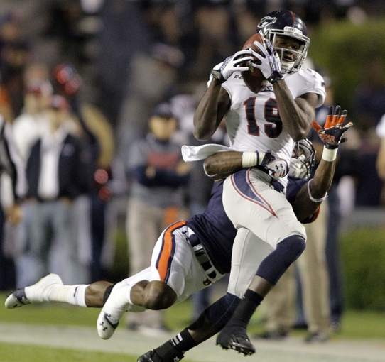 Oct 26, 2013; Auburn, AL, USA; Florida Atlantic Owls receiver William Dukes (19) makes a catch as Auburn Tigers linebacker Cassanova McKinzy (8) makes the tackle during the first half at Jordan Hare Stadium. Mandatory Credit: John Reed-USA TODAY Sports