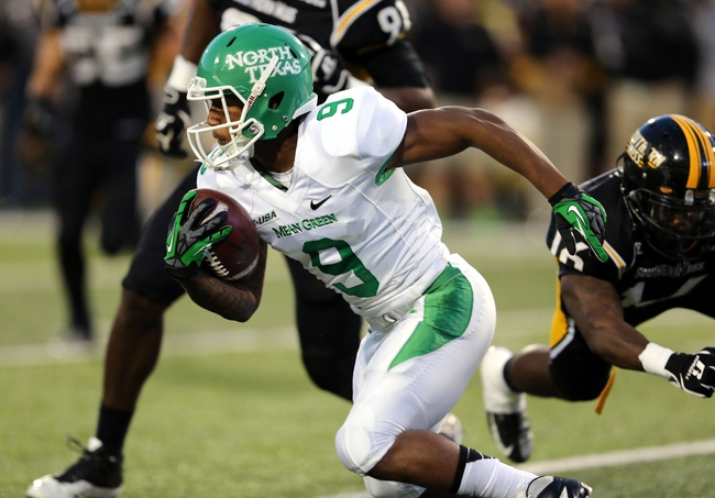 Oct 26, 2013; Hattiesburg, MS, USA; North Texas Mean Green wide receiver Carlos Harris (9) runs after a catch against the Southern Miss Golden Eagles in the first quarter of their game at M.M. Roberts Stadium. Mandatory Credit: Chuck Cook-USA TODAY Sports