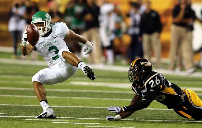 Oct 26, 2013; Hattiesburg, MS, USA; North Texas Mean Green wide receiver Brelan Chancellor (3) makes a catch in front of Southern Miss Golden Eagles defensive back Debarriaus Miller (26) in the first quarter of their game at M.M. Roberts Stadium. Mandatory Credit: Chuck Cook-USA TODAY Sports