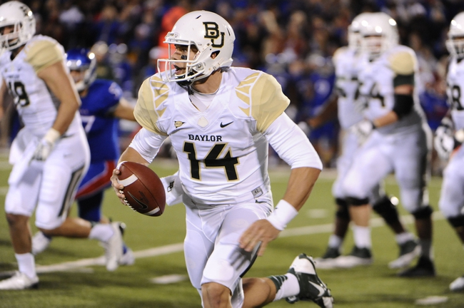 Oct 26, 2013; Lawrence, KS, USA; Baylor Bears quarterback Bryce Petty (14) runs with the ball against the Kansas Jayhawks in the first half at Memorial Stadium. Mandatory Credit: John Rieger-USA TODAY Sports