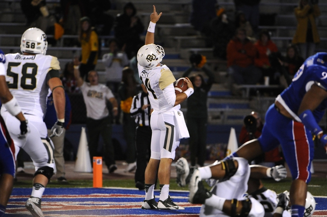 Oct 26, 2013; Lawrence, KS, USA; Baylor Bears quarterback Bryce Petty (14) celebrates after scoring a touchdown against the Kansas Jayhawks in the first half at Memorial Stadium. Mandatory Credit: John Rieger-USA TODAY Sports