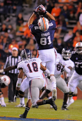 Oct 26, 2013; Auburn, AL, USA; Auburn Tigers tight end C.J. Uzomah (81) catches a pass ahead of Florida Atlantic Owls defensive back Christian Milstead (18) during the first half at Jordan Hare Stadium. Mandatory Credit: Shanna Lockwood-USA TODAY Sports