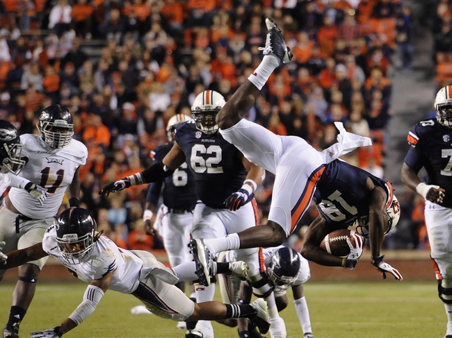 Oct 26, 2013; Auburn, AL, USA; Auburn Tigers wide receiver Sammie Coates (18) goes airborne over the defense of the Florida Atlantic Owls at Jordan Hare Stadium. Mandatory Credit: Shanna Lockwood-USA TODAY Sports