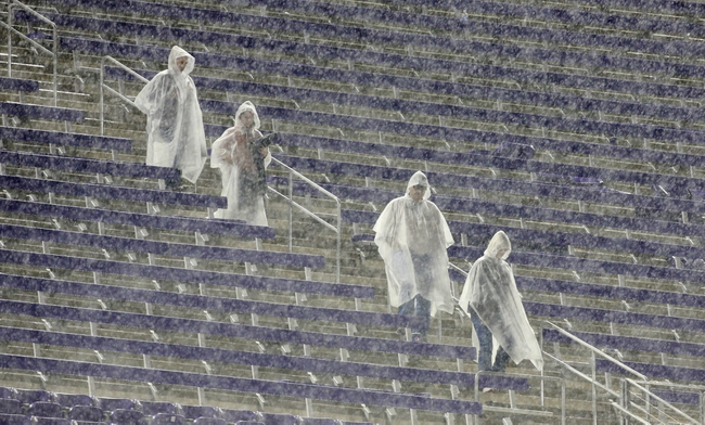 Oct 26, 2013; Fort Worth, TX, USA; Fans walk in the stands during a rain delay in the game between the Texas Longhorns and the TCU Horned Frogs at Amon G. Carter Stadium. Mandatory Credit: Tim Heitman-USA TODAY Sports