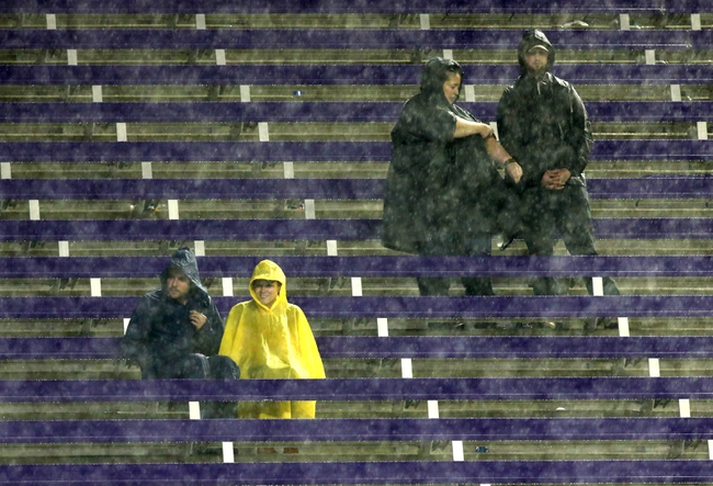 Oct 26, 2013; Fort Worth, TX, USA; Fans sit in the stands during a rain delay in the game between the Texas Longhorns and the TCU Horned Frogs at Amon G. Carter Stadium. Mandatory Credit: Tim Heitman-USA TODAY Sports