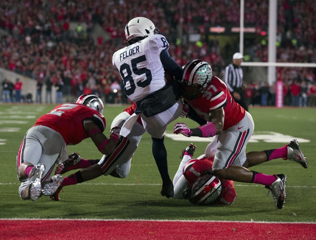 Oct 26, 2013; Columbus, OH, USA; Penn State Nittany Lions wide receiver Brandon Felder (85) spins through a tackle attempted by Ohio State Buckeyes linebacker Joshua Perry (37) at Ohio Stadium. Mandatory Credit: Greg Bartram-USA TODAY Sports