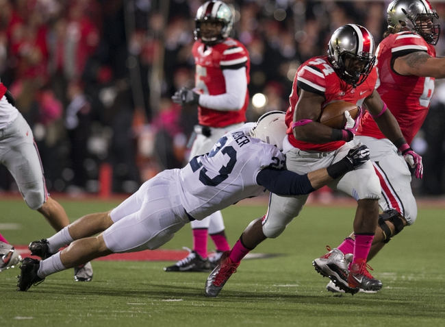 Oct 26, 2013; Columbus, OH, USA; Ohio State Buckeyes running back Carlos Hyde (34) pulls away from Penn State Nittany Lions safety Ryan Keiser (23) at Ohio Stadium. Mandatory Credit: Greg Bartram-USA TODAY Sports
