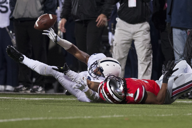 Oct 26, 2013; Columbus, OH, USA; Penn State Nittany Lions wide receiver Chris Geiss (6) tries to keep the ball from hitting the ground as Ohio State Buckeyes cornerback Bradley Roby (1) defends at Ohio Stadium. Mandatory Credit: Greg Bartram-USA TODAY Sports