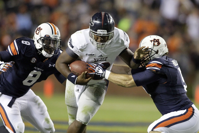 Oct 26, 2013; Auburn, AL, USA; Auburn Tigers linebackers Jake Holland (5) and Cassanova McKinzy (8) close in on Florida Atlantic Owls quarterback Jaquez Johnson (12) during the second half at Jordan Hare Stadium. The Tigers beat the Owls 45-10.  Mandatory Credit: John Reed-USA TODAY Sports
