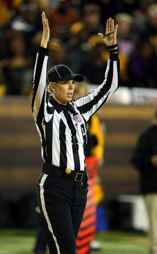 Oct 26, 2013; Hattiesburg, MS, USA; C-USA official Sarah Thomas signals a touchdown by the North Texas Mean Green in the second half of their game against the Southern Miss Golden Eagles at M.M. Roberts Stadium. North Texas won, 55-14. Mandatory Credit: Chuck Cook-USA TODAY Sports