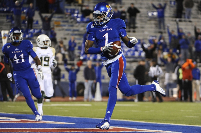 Oct 26, 2013; Lawrence, KS, USA; Kansas Jayhawks wide receiver Rodriguez Coleman (1) scores a touchdown against the Baylor Bears in the second half at Memorial Stadium. Baylor won 59-14. Mandatory Credit: John Rieger-USA TODAY Sports