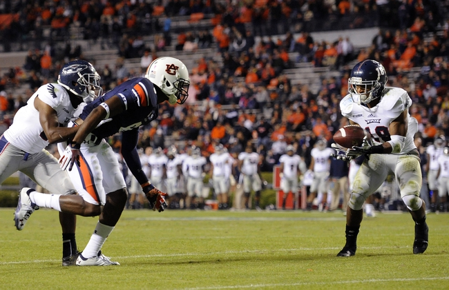 Oct 26, 2013; Auburn, AL, USA;  Florida Atlantic Owls defensive back Christian Milstead (18) intercepts a pass intended for Auburn Tigers wide receiver Tony Stevens (8) at Jordan Hare Stadium. The Tigers beat the Owls 45-10. Mandatory Credit: Shanna Lockwood-USA TODAY Sports