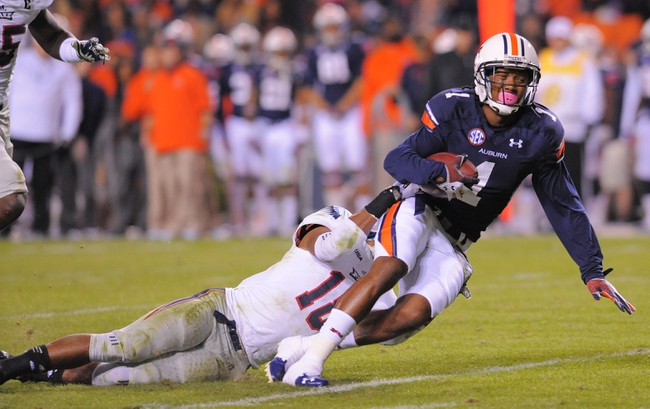 Oct 26, 2013; Auburn, AL, USA; Auburn Tigers wide receiver Trovon Reed (1) is brought down by Florida Atlantic Owls defensive back Christian Milstead (18) at Jordan Hare Stadium. The Tigers beat the Owls 45-10. Mandatory Credit: Shanna Lockwood-USA TODAY Sports