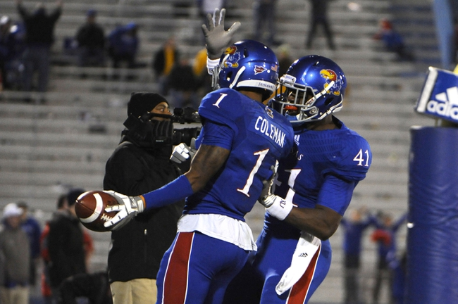Oct 26, 2013; Lawrence, KS, USA; Kansas Jayhawks wide receiver Rodriguez Coleman (1) is congratulated by tight end Jimmay Mundine (41) after scoring a touchdown against the Baylor Bears in the second half at Memorial Stadium. Baylor won 59-14. Mandatory Credit: John Rieger-USA TODAY Sports