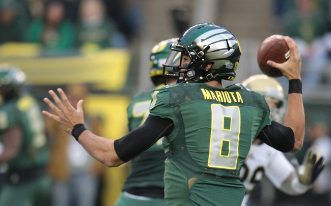 Oct 26, 2013; Eugene, OR, USA; Oregon Ducks quarterback Marcus Mariota (8) throws the ball against the UCLA Bruins at Autzen Stadium. Mandatory Credit: Scott Olmos-USA TODAY Sports
