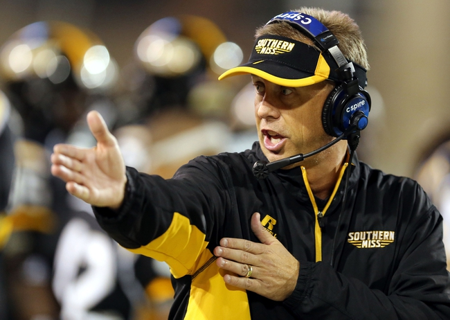 Oct 26, 2013; Hattiesburg, MS, USA; Southern Miss Golden Eagles head coach Todd Monken talks to his players on the sidelines in the second half against the North Texas Mean Green at M.M. Roberts Stadium. North Texas won 55-14. Mandatory Credit: Chuck Cook-USA TODAY Sports